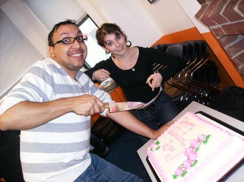 Todd and Katya cut the cake