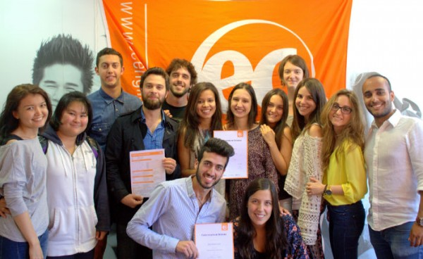 Students with their certificates for learning English at EC Brighton