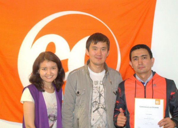 Yerbol with his certificate for learning English at EC Brighton