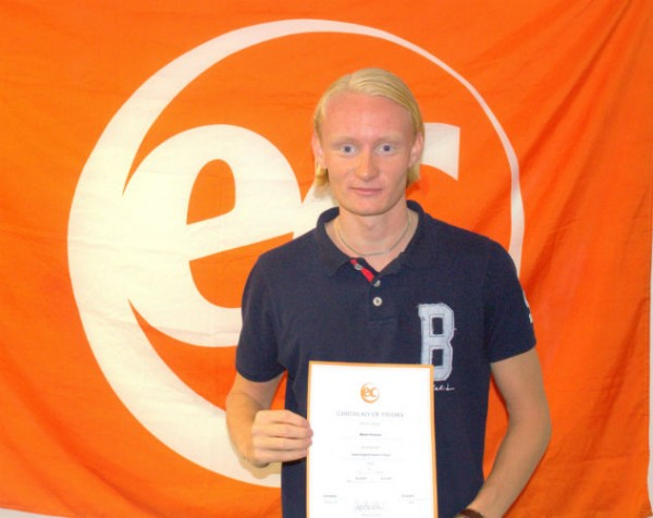 Martin with his certificate for learning English at EC Brighton English School