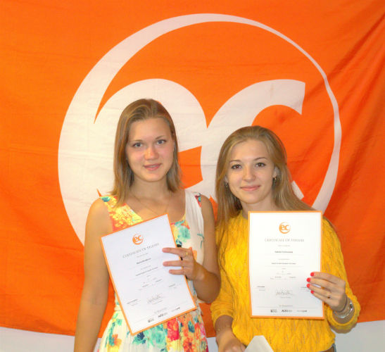 Valeriia and Marina with their certificates for learning English at EC Brighton English School