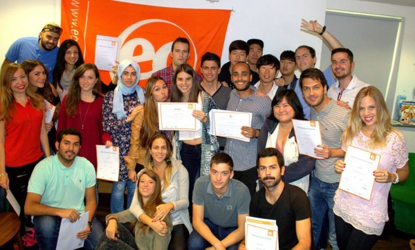Students receive certificates after studying English in the UK