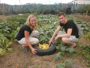 Beatrice and Sandro recycling the banana peels in the vegetable garden