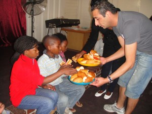 Ashraf serving the children