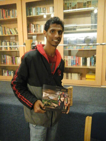 Ahmed Bafgeesh donating his book to EC Cape Town's Library