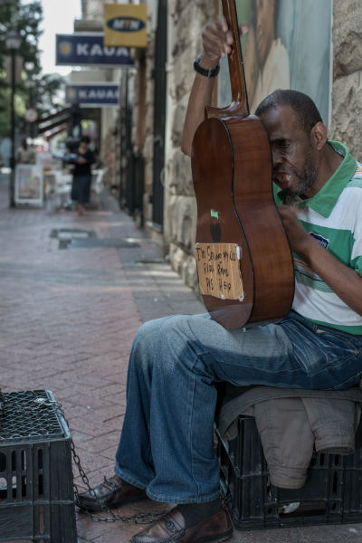 Goodman Nono is back at Greenmarket Square, busking for a living.  This photograph is part of the art project for  EC language school Cape Town