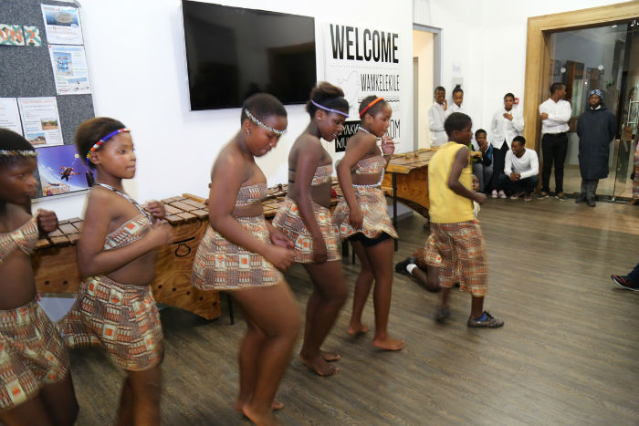 Traditional African dancers wow their audience at the party!
