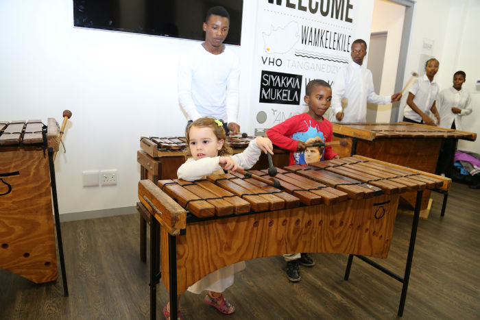 Some of our young guests who could not resist the call of the marimbas