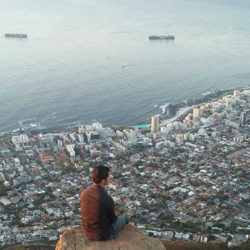 Hamza looking at Cape Town from the top of Table Mountain. Mountain hikes happen every month at EC Cape Town English School
