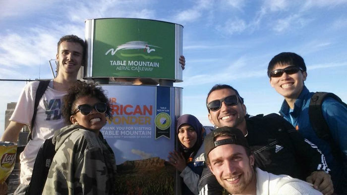 Jason with some of his friends on Table Mountain, which can be seen from EC Cape Town