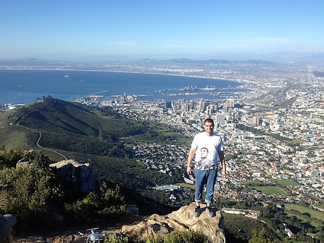 Maycon standing at the top of Table Mountain, one of the top attractions for EC Cape Town students