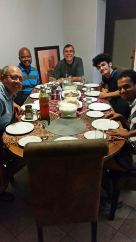 David (in the middle) with his host father and other EC Cape town student enjoying dinner