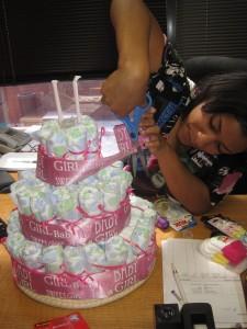 Lykai assembles the diaper cake.