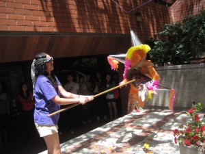Sang Hee successfully breaks open the pinata.