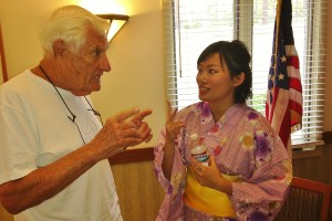 ECSD student Xiaochi Xie (Christina) enthusiastically speaks with a local resident about Japanese festivals