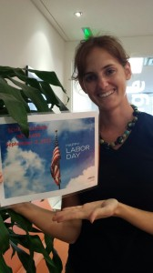 Leti shows off our Labor Day ad!