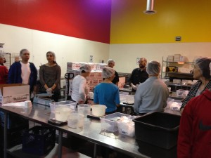 Volunteers receive instructions...packing granola into 1 pound packages