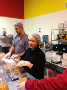 Sara working with other volunteers to pack granola.