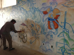 Here is an artist working on the huge mural in the lounge/dining area of The Monastery.
