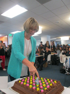 Our Center Director, Cindy Ochoa, with the 4th year anniversary cake!