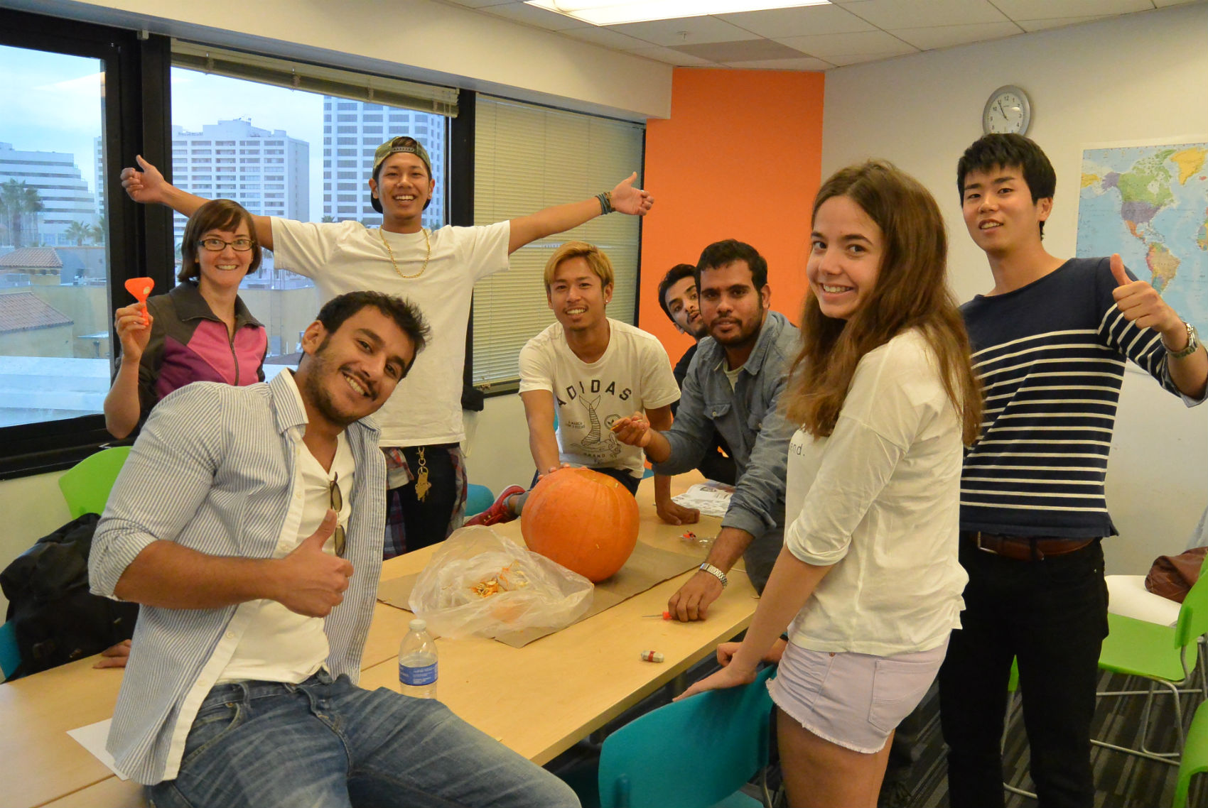 Students carving a pumpkin