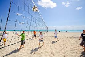 Playing volleyball on the beach!