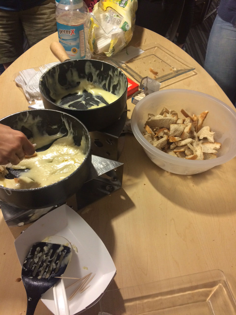 Dip bread into cheese and enjoy Fondue!