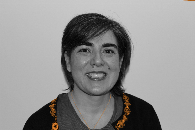 Ana Arroyo- Director of Studies black-& orange