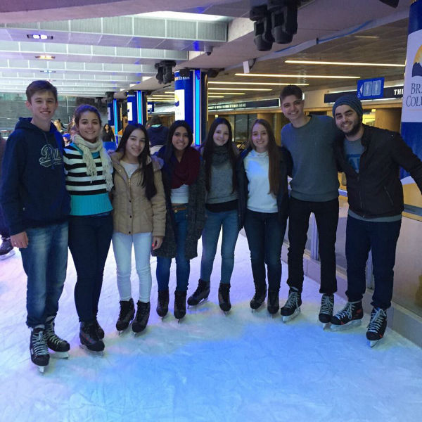 Breno and his friends posing on the Robson Square Ice Rink