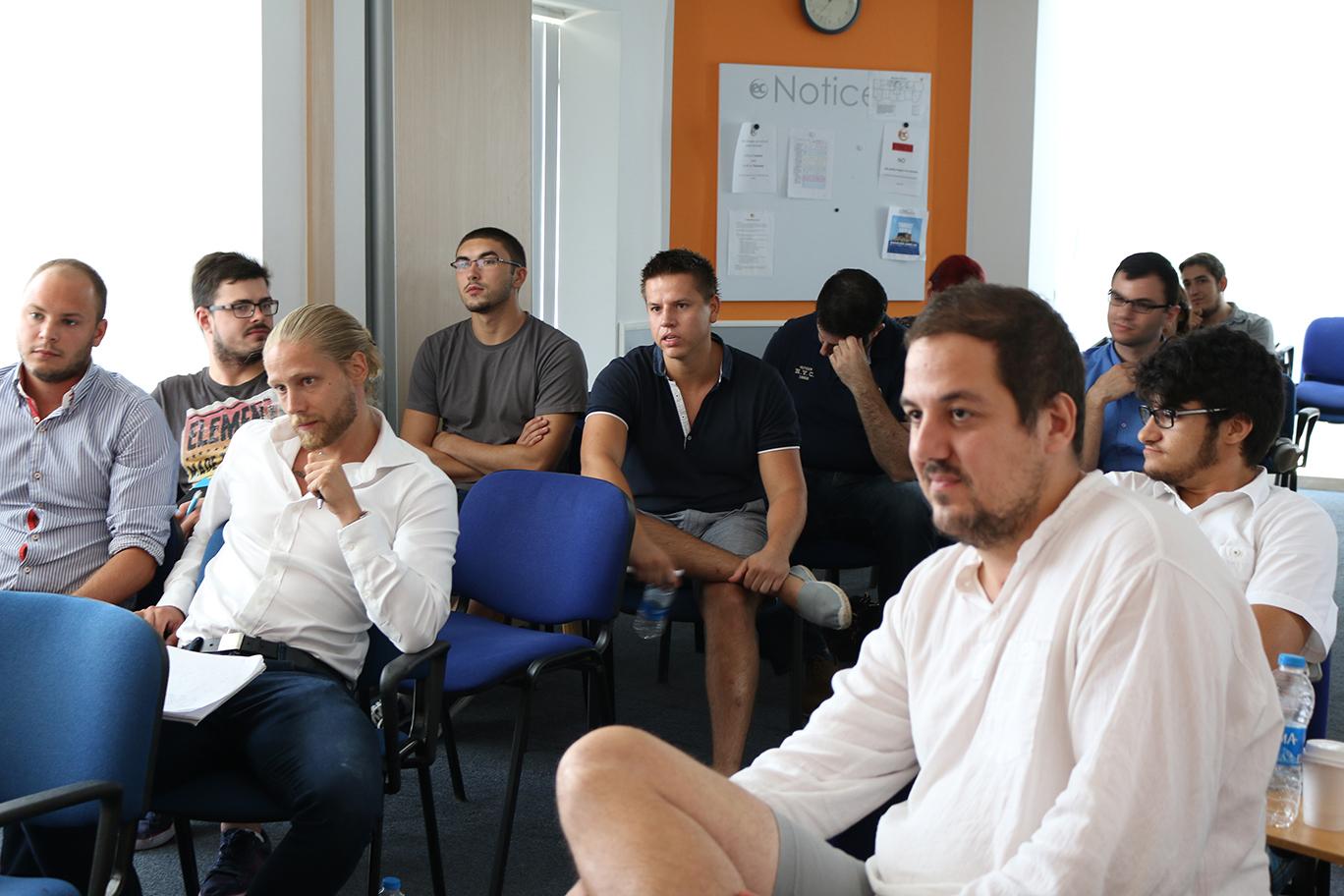 SEO professionals at an informal meetup with Webmaster Trends Analyst John Mueller