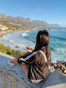 EC Cape Town student overlooking the ocean.