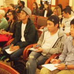 EC San Diego students listen to their peers' presentations and take notes in English