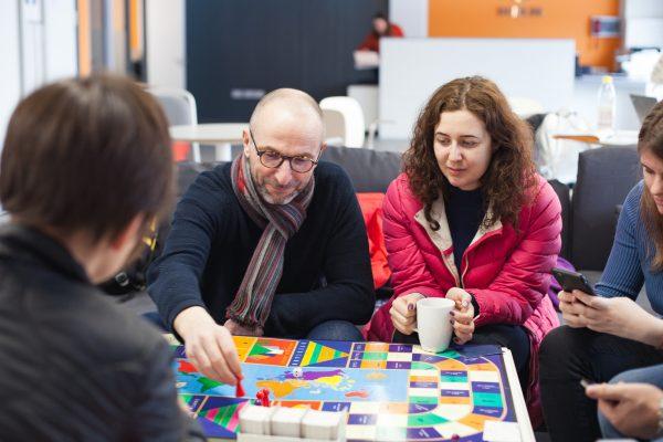 Bonding over games in the EC Dublin 30+ student lounge.