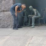 Thales discussing his TOEFL questions with a friend